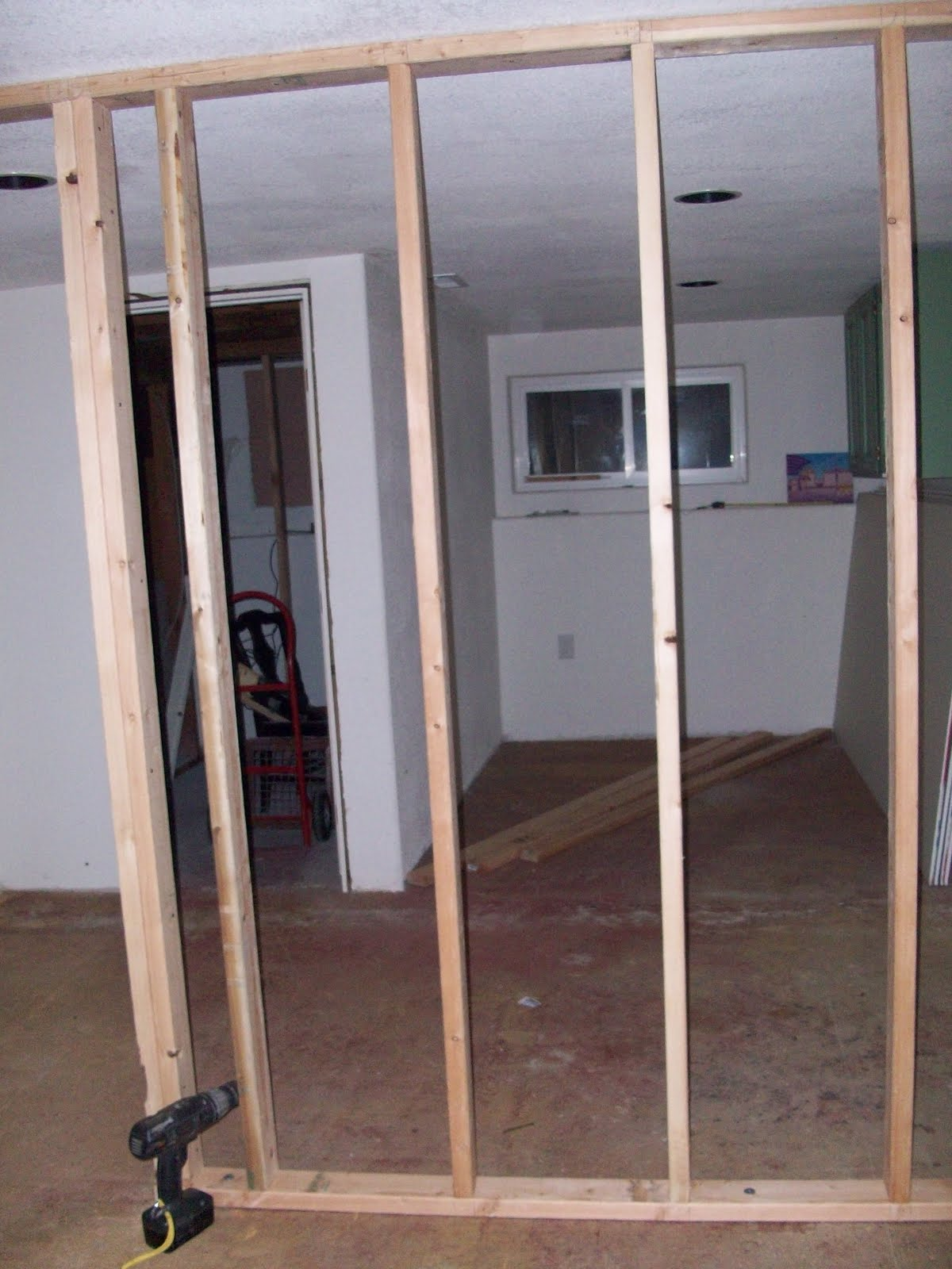 our old new house project framing a wall in the basement