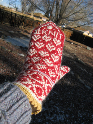 "I decided how to end my mitten: It says, ""II KNIT""."