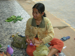 Cambodian Student Weaving 'Embracelets'
