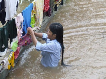 Salvaging Laundry at Height of Rain