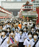 swine flu spreading in japan, forcing school closures