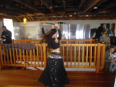 Photo of the belly dancers spinning with a sword