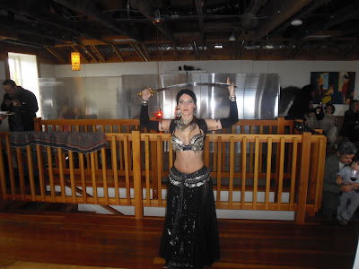 Photo of the belly dancer dancing with a sword above her head