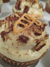apple puree stuffed carrot cupcakes with cream cheese frosting cinnamon sugared pecans