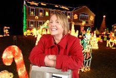 Judy at one of the many houses on Christmas Street