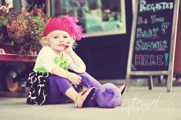 picture of a toddler dressed in designer clothes from Bella Luna Maternity in the Chestnut Street District, downtown Hays, KS.