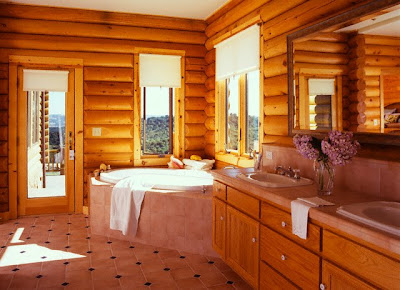 Amazing-log-home-bathroom-with-wooden-walls-tiles-flooring-furnished-with-wooden-vanity-double-washbasins--convinient-bathtub-and-small-windows