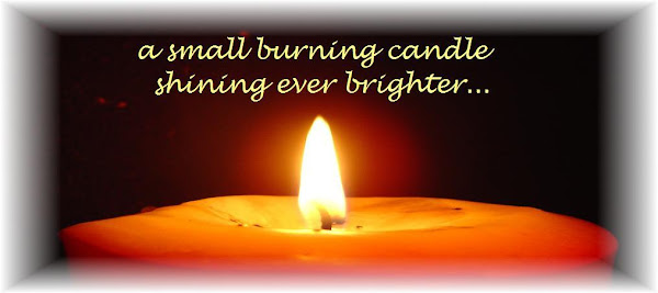 A SMALL BURNING CANDLE