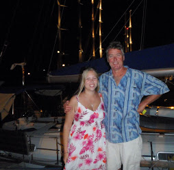 Ky & Peter with spreader lights in backgroun of superyacht alley