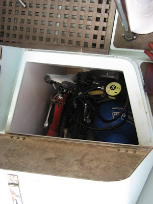 Enlarged locker already full with rescued abandoned folding bike, dive tank, gas etc