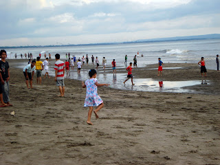 balis people loves to play on the beach on the weekend