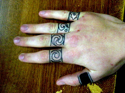 Ring Tattoos Designs on Five Rings   Tattoo Pictures   Tattoo Designs
