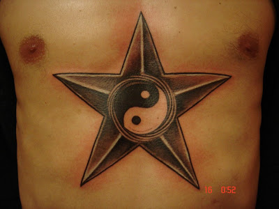 Star and Yin Yang Tattoo [Image Credit: augrust]