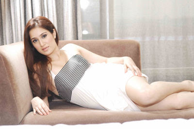 Sagarika Ghatge on a couch
