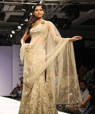 Krishna Somani walks on ramp during KFW