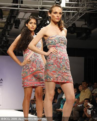 Models display work by Mandira Wirk