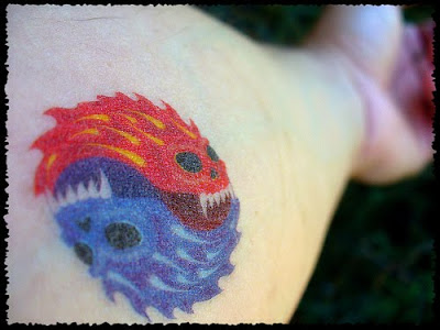 yin yang tattoo designs on COOL TATTOOS DESIGN PICTURES: Yin Yang Flame Tattoo Design Hand