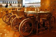 Image of Wheelchairs at a Restaurant Table