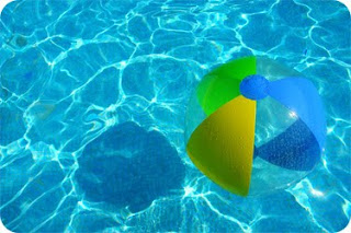 photo of a beach ball in a pool
