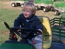 Logan on Tractor