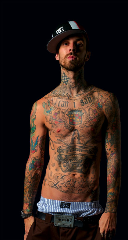 Travis Barker tattoos combination of old school and new school tattoos.