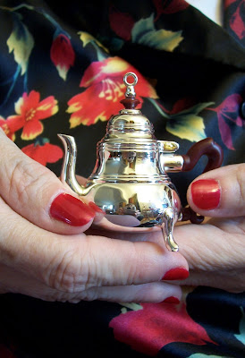 Stef's photo of a tiny silver teapot