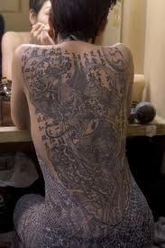 Japanese tattoo art on a beautiful girls back