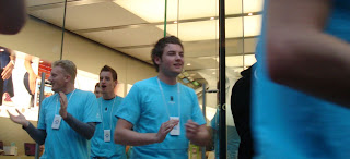 Belfast Apple Store - staff running out to cheer on queuing customers before the store opened