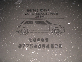 Print photoed on pavement in Victoria Square - advertising a Mini One for sale