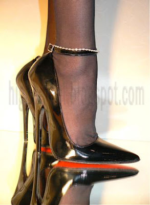 black 6 inch pumps with a red sole
