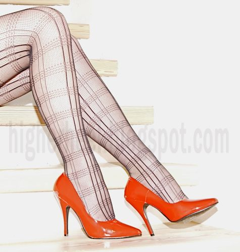 classic red stiletto pumps and fishnet stockings