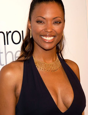 Her name is Aisha Tyler She's a comedienne who loves video games.