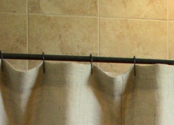 top of shower curtain showing placement of shower curtain hooks