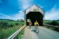 Cyclist pass thru covered bridge