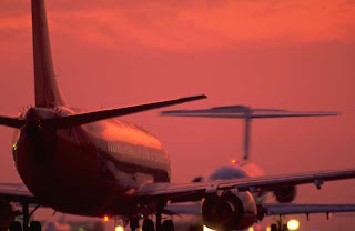airliners taxiing in sunset