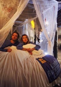 Laterooms promotional pic: Couple in bed in London Dungeon