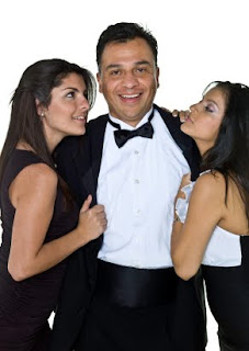 Man in dinner jacket with two girls