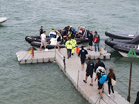 Extreme sailing VIPs on pontoon