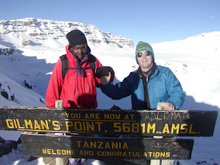 my dad and a guide on Kilimanjaro