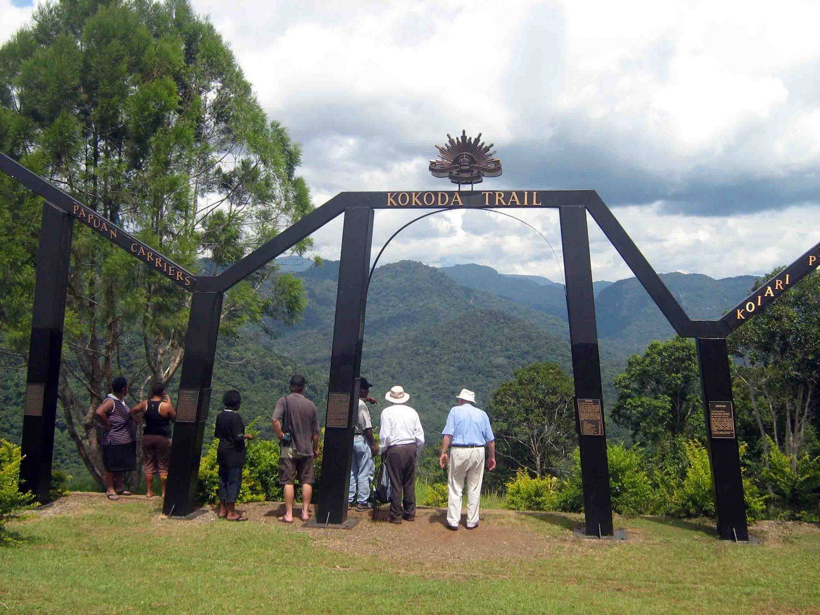 [Visitors+looking+at+the+Kokoda+Trail+from+Owers]