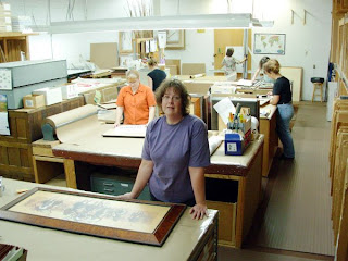 Peggy (in blue) rules the roost in Gallery One's framing department