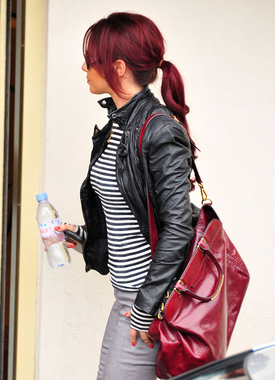 Mousing around: Cheryl Cole wore her long red hair pinned up in a Minnie