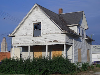 [House moved to make way for urban redevelopment, Lincoln]