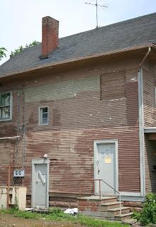 [House chimney demolished for urban redevelopment]