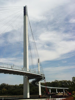 [View of the pedestrian bridge from the Omaha riverfront.]