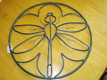 """Dragonfly"" with outer circle"