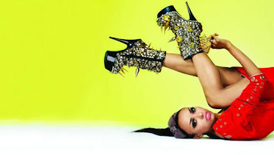 Kat Graham photoshoot red and black and gold outfit.