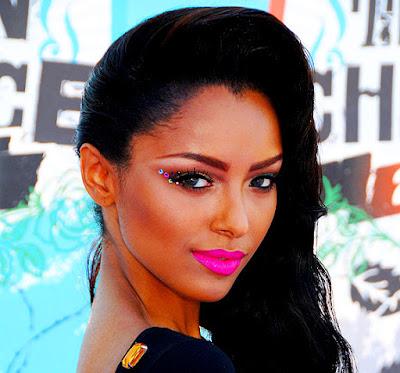 Kat Graham beauty make up pink lips and glitter eye shadow.