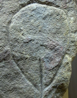 Paleolithic engraving of a vulva