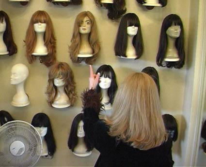 Mannequin with a variety of wigs that were donated